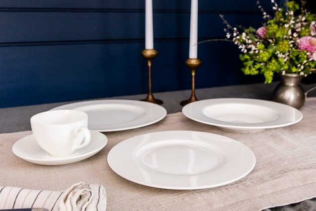 a set of green Villeroy & Boch Royal 30-Piece hard dick clay dinnerware on a collection furniture.