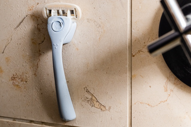 The billie shave attached with a shower outlet.