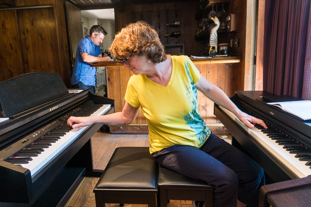 Tester Liz Kinnon relaxes on a vase regular within the two pianos, with an offer for each, assessing the buttons.