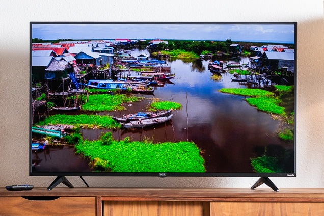 The TCL 5-Series spending plan 4K TV with a yet of a marsh and fishing boats exhibit to the analyze.