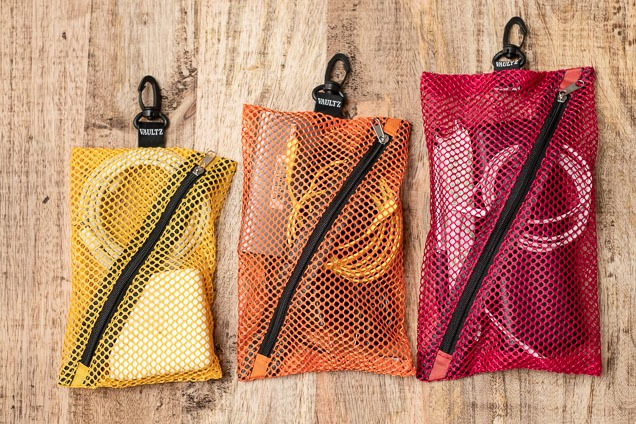 Three Vaultz interlock purse planners in different semblance and sizes, each keeping unlike objects.