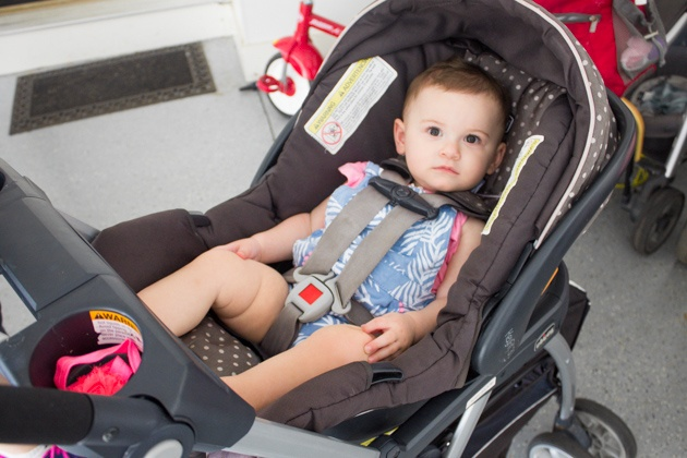 A baby sitting within Chicco KeyFit 30 baby stroller.