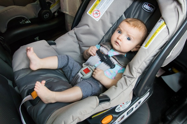 A baby-sitting in Chicco KeyFit 30 infant car seat.
