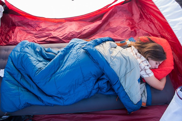 A girlfriend asleep in a camp in our runner-up choice for the very best asleep base for car camp.