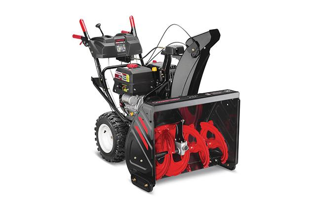 A white and dark colored Troy-Bilt Arctic tornado 30 on a red history.