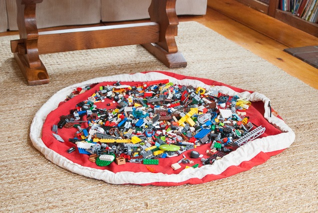 Hundreds of Lego fragments sitting in an unbarred, flattened pounce container, one of our toy retention recommendations.