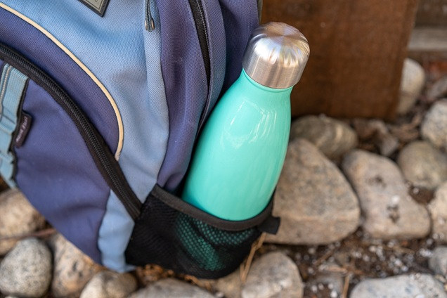 The Simple fashionable 17oz Wave lake sprayer during the transporting bag on a backpack.