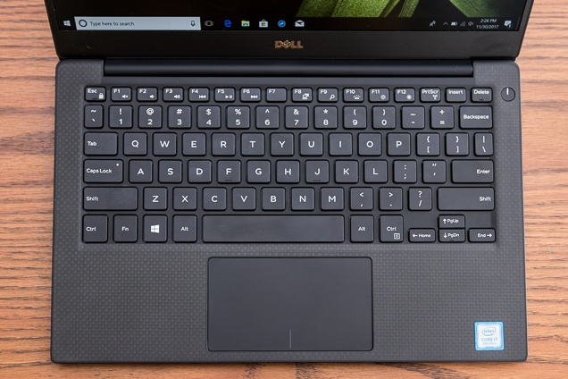 A evaluate the XPS' keys and trackpad.